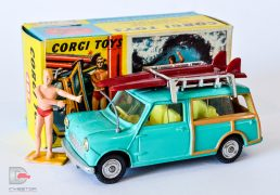 Corgi No.485 BMC Mini Countryman turquoise, yellow interior, spun hubs, grey plastic aerial, chrome roof rack, complete with 2 x maroon surfboards and plastic figure - overall condition is Near Mint, superb example, in generally Excellent blue and yellow carded picture box comes complete with correct folded instruction sheet.