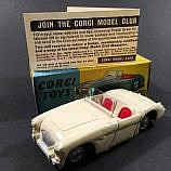 Corgi No.300 Austin Healey Sports Car - cream body, red seats, shaped spun hubs - Excellent Plus to Near Mint in Excellent plain blue and yellow card box with model number stamped to end flaps, model club leaflet.