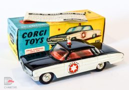 "Corgi No.237 Oldsmobile ""County Sheriff"" Car - black, white, red interior and roof-light, chrome spun hubs - Excellent example in an excellent blue and yellow carded picture box with collectors club folded leaflet."