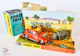 "Corgi No.256 Volkswagen 1200 ""East African Safari"" - orange body, brown left hand drive interior, chrome trim, spun hubs - Excellent plus including inner pictorial stand with packing piece which are near mint. Wheel cut outs still intact as are pull tabs. Also comes with rhino figure and correct collectors club folded leaflet, outer blue and yellow carded picture box is Near Mint superb example, pencil price to one end."