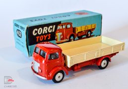 Corgi No.452 Commer Dropside Lorry red cab and chassis, cream back, flat spun hubs, tow hook, silver trim. Excellent still a bright example in a Good Plus blue carded picture box.