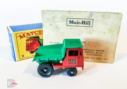 "Matchbox Regular Wheels No.2c Muir Hill Site Dumper ""Muir Hill"" - red cab and chassis without silver grille - Mint in Mint correct issue type E3 box. Comes with an old business card belonging to E.L Briggs who was the manager of the publicity department at Muir Hill who originally ordered these models as promotional items to be given out by sales reps. This model was purchased from the family."