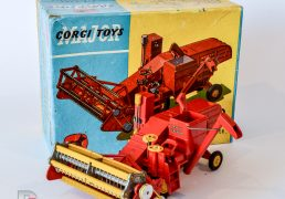 Corgi No.1111 Massey Ferguson 780 Combine Harvester finished in red including hubs, dark yellow metal tynes, one has fatigue and been repaired, bright yellow plastic parts with Figure Driver - overall condition is good plus to excellent in a generally good plus blue and yellow lift off lid picture box complete with correct inner packing pieces.