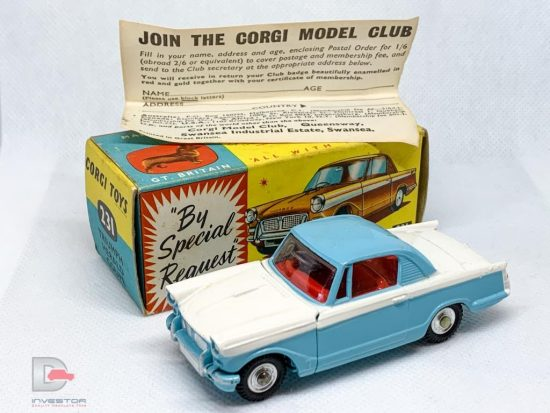 Corgi 231 Triumph Herald Coupe - two-tone blue, white, red interior, silver trim, spun hubs - Mint a beautiful example in a Good Plus blue and yellow carded picture box with collectors club folded leaflet.