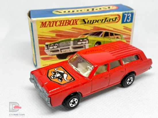 """Matchbox Superfast No.73a Mercury Commuter - red body with """"Bulls Head"""" hood label and without fuel filler flap cast, high arches, clear windows, ivory interior, bare metal """"No.59 or 73"""" base, 5-spoke wide wheels - Mint in Near Mint """"New"""" type G box."""