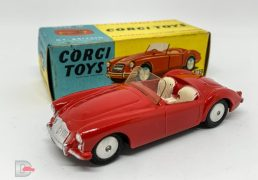 Corgi No.302 MGA Sports Car - red body, cream seats, silver trim, flat spun hubs - Excellent Plus lovely bright example in a Good Plus blue and yellow carded picture box.