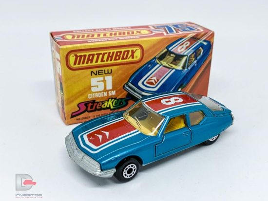 "Matchbox Superfast 51b Citroen SM Streakers issue - metallic blue body with red & white racing number 8 tampo print which has a fishtail edge to trunk tampo, clear windows, dark yellow interior, bare metal base, dot-dash wheels - Mint in Mint ""New"" type J box."