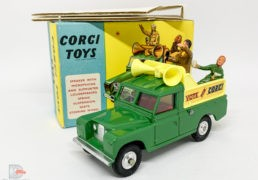 """Corgi 472 Land Rover Public Address Vehicle """"Vote for Corgi"""" – green, yellow plastic back and speakers, red interior, silver trim, 2 x figures, spun hubs – Near Mint lovely bright example in a a very crisp box that would be near mint apart from the cellotape marks. Also comes with correct inner packing piece and collectors club folded leaflet."""