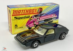 """Matchbox Superfast 5a Lotus Europa – black body with high arches & gold """"JPS"""" tampo print, clear windows, ivory interior, bare metal base with cast shut tow slot, 5-spoke wide wheels – Near Mint in Near Mint to Mint type I box without """"New""""."""