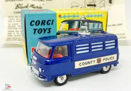 """Corgi 464 Commer """"County Police"""" Van - blue body, red interior, silver trim, spun hubs, clear battery-operated roof light - Very near mint, most would say mint in a near mint and yellow carded picture box with correct collectors club/instruction sheet. A lovely bright example that displays very nicely."""