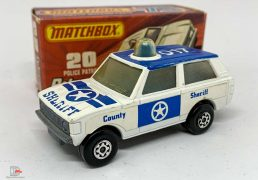 """Matchbox Superfast No.20b Range Rover Police Patrol - white body with blue Sheriff tampo print, """"County Sheriff"""" side labels, clear frosted windows, blue spinner and roof light, bare metal base, Maltese Cross wheels - Good Plus in Excellent type J box."""