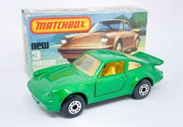 """Matchbox Superfast 3c Porsche 911/930 Turbo - metallic emerald green body (slightly lighter shade), clear windows, 5-arch wheels light yellow interior, gloss black base; Excellent Plus with some factory assembly marks/chips to base in Excellent to Excellent Plus """"New"""" type K box."""