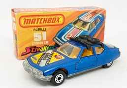 """Matchbox Superfast 51b Citroen SM twin pack issue - metallic blue body with Yamaha hood label, black plastic roof-rack, clear windows, dark yellow interior, bare metal base without model number cast, dot-dash wheels - Excellent Plus (body unmarked but some glue showing through decal) in Excellent a little creased at one end """"New"""" type J Streakers box."""