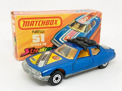 "Matchbox Superfast 51b Citroen SM twin pack issue - metallic blue body with Yamaha hood label, black plastic roof-rack, clear windows, dark yellow interior, bare metal base without model number cast, dot-dash wheels - Excellent Plus (body unmarked but some glue showing through decal) in Excellent a little creased at one end ""New"" type J Streakers box."