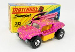 """Matchbox Superfast 30b Beach Buggy - metallic candy pink with medium splatter of yellow spots, clear windows, dark yellow interior, chrome engine with large exhausts, bare metal base, spiro wheels - Mint in Good Plus type I box without """"New""""."""