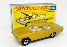 Matchbox Superfast 36c Opel Diplomat (Superfast 36a) - metallic dark gold body with silver grille, chrome engine, clear windows, white interior, gloss black base, hollow small diameter 5-spoke narrow wheels - Mint in excellent plus (1cm tear to one side flap) type F3 transitional issue box with matching model artwork.