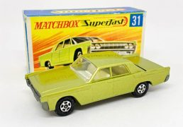 """Matchbox Superfast 31c Lincoln Continental (Superfast 31a) - metallic lime green body with low arches, clear windows held by punched rivet, ivory interior, bare metal base, small diameter solid 5-spoke narrow wheels - Near Mint with usual small factory assembly mark below rear window in Near Mint """"New"""" type G box with """"TM"""" and matching model artwork."""
