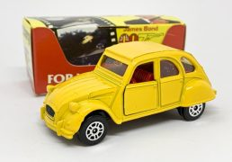 """Corgi Juniors No. 115 """"James Bond"""" Citroen 2CV taken from the film """"For Your Eyes Only"""" - bright yellow, red interior, chrome trim - Mint in a Mint film strip carded box."""